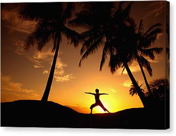 Yoga At Sunset Canvas Print by Ron Dahlquist - Printscapes