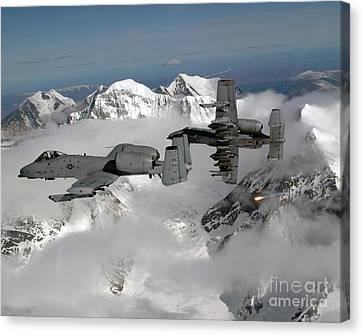 A-10 Thunderbolt IIs Fly Canvas Print by Stocktrek Images