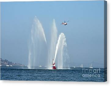 A Fire Boat Canvas Print by Ted Kinsman