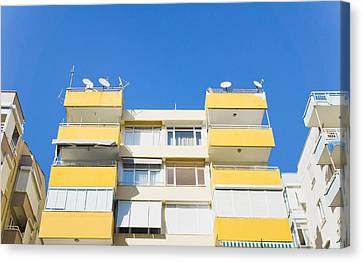 Apartment Building Canvas Print by Tom Gowanlock