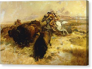 Buffalo Hunt Canvas Print by Charles Marion Russell