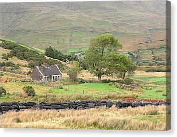 Cottage At The Foothill Of The Colorful Connemara Mountains Ireland  Canvas Print by Pierre Leclerc Photography