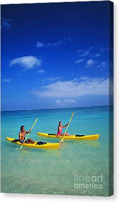 Couple Paddling Canvas Print by Kyle Rothenborg - Printscapes