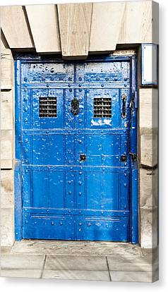 Old Blue Door Canvas Print by Tom Gowanlock