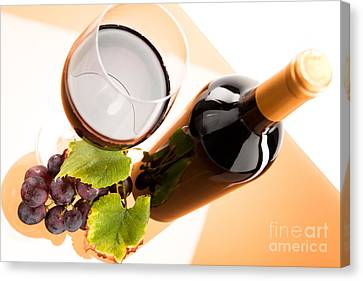 Red Wine In Glass With Bottle And Wine Grapes Canvas Print by Wolfgang Steiner