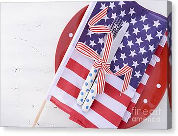 Usa Party Table Place Setting With Flag On White Wood Table.  Canvas Print by Milleflore Images