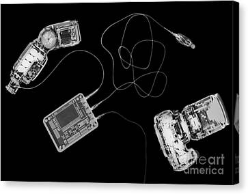 X-ray Of A Digital Camera And Ipod Canvas Print by PhotoStock-Israel