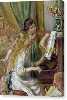 Young Girls At The Piano Canvas Print by Pierre-Auguste Renoir