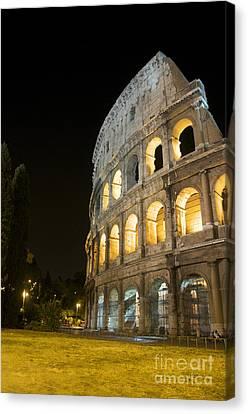 Coliseum Illuminated At Night. Rome Canvas Print by Bernard Jaubert