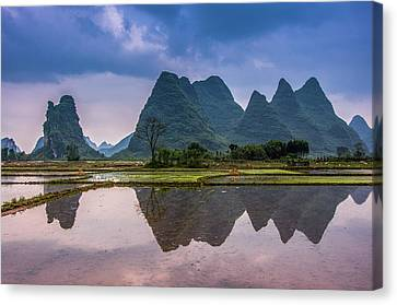 Karst Mountains And Rural Scenery Canvas Print by Carl Ning