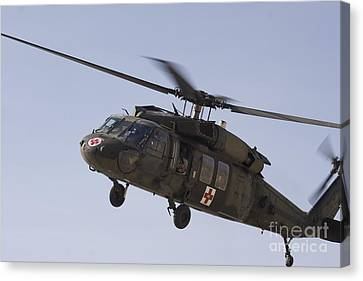 A Uh-60 Blackhawk Medivac Helicopter Canvas Print by Terry Moore