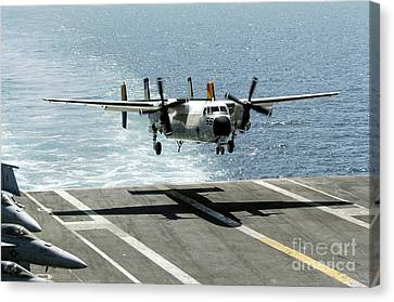 A C-2a Greyhound Prepares To Land Canvas Print by Stocktrek Images
