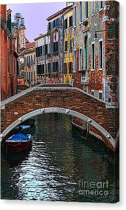 A Canal In Venice Canvas Print by Tom Prendergast