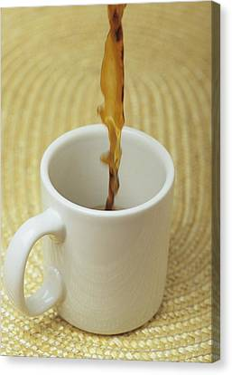 A Cup Of Energy Filled Coffee Is Poured Canvas Print by Taylor S. Kennedy