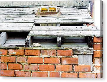 A Damaged Roof Canvas Print by Tom Gowanlock