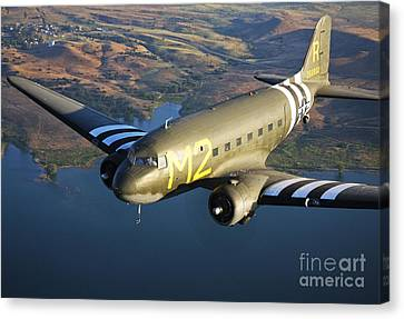 A Douglas C-53 Skytrooper In Flight Canvas Print by Scott Germain