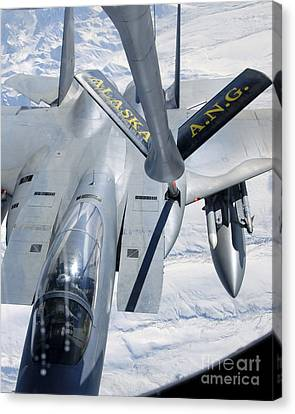 A F-15 Eagle Refuels Behind A Kc-135 Canvas Print by Stocktrek Images