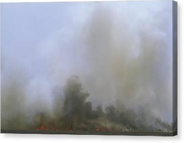A Fire Burns In The Marsh On Ocracoke Canvas Print by Stephen Alvarez