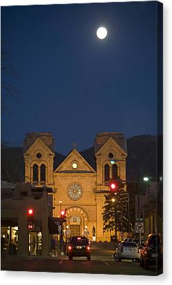 A Full Moon Rises Over  Cathedral Canvas Print by Stephen St. John