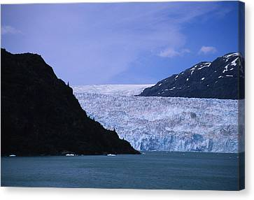 A Glacier Spills Into The Prince Canvas Print by Stacy Gold