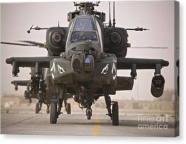 A Group Of Ah-64d Apache Helicopters Canvas Print by Terry Moore