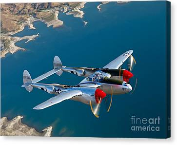 A Lockheed P-38 Lightning Fighter Canvas Print by Scott Germain