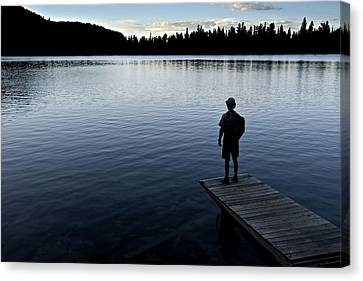 A Man Looking Across A Lake. Into Canvas Print by Dawn Kish