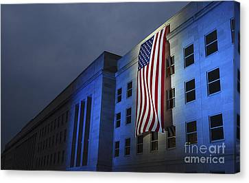 A Memorial Flag Is Illuminated On The Canvas Print by Stocktrek Images
