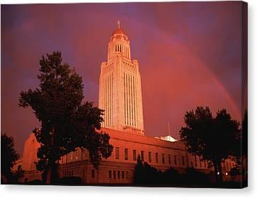 A Rainbow Shines Over The Nebraska Canvas Print by Joel Sartore