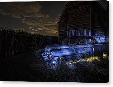 A Rusty 50's Cadillac In Painted Blue And Yellow Light One Starry Night Canvas Print by Sven Brogren