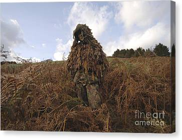 A Sniper Dressed In A Ghillie Suit Canvas Print by Andrew Chittock