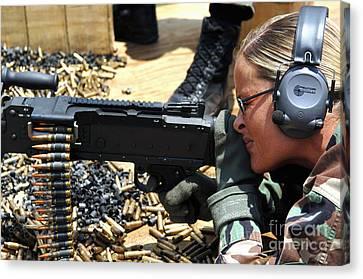 A Soldier Fires An M240b Medium Machine Canvas Print by Stocktrek Images