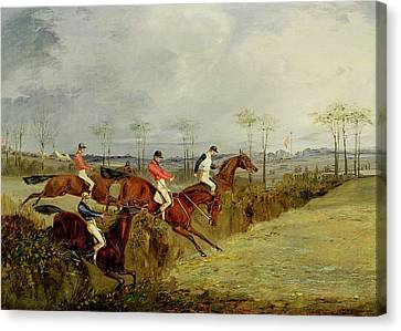 A Steeplechase - Taking A Hedge And Ditch  Canvas Print by Henry Thomas Alken