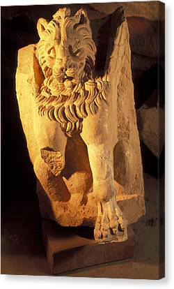 A Temple Winged Lion In The Petra Canvas Print by Richard Nowitz