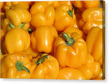 A Trip Through The Farmers Market Featuring Yellow Bell Peppers Canvas Print by Michael Ledray