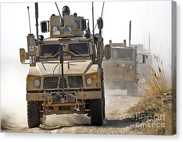A U.s. Army M-atv Leads A Convoy Canvas Print by Stocktrek Images