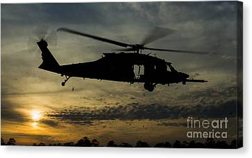 A U.s. Army Uh-60 Black Hawk Leaves Canvas Print by Stocktrek Images