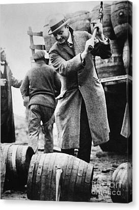 A Us Federal Agent Broaching A Beer Barrel From An Illegal Cargo During The American Prohibition Era Canvas Print by American School