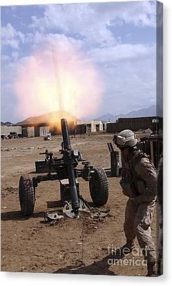 A U.s. Marine Corps Gunner Fires Canvas Print by Stocktrek Images