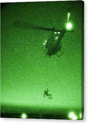 A U.s. Marine Rappels From A Uh-1n Huey Helicopter Canvas Print by Celestial Images