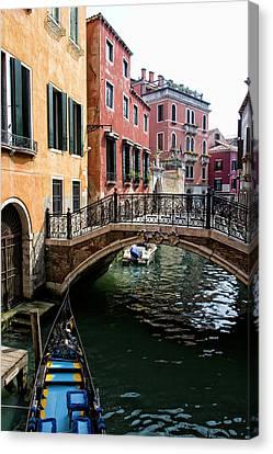 A Venetian Canal Canvas Print by Michelle Sheppard