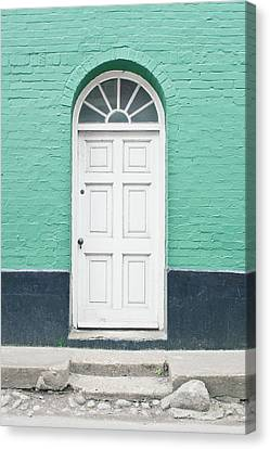 A White Door Canvas Print by Tom Gowanlock