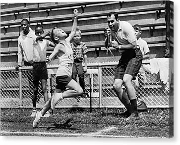 A Young Athlete Sprinting Canvas Print by Underwood Archives