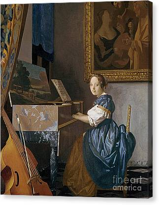 A Young Lady Seated At A Virginal Canvas Print by Jan Vermeer