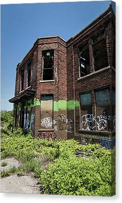 Abandoned Building With Graffiti Canvas Print by Kim Hojnacki