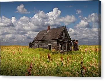 Abandoned Prairie Farm House Under Cloudy Blue Skies Canvas Print by Randall Nyhof