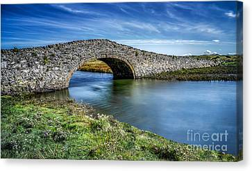 Aberffraw Bridge Canvas Print by Adrian Evans