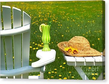 Adirondack Chair On The Grass  Canvas Print by Sandra Cunningham