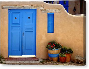 Adobe Walls With Blue Doors Ranchos De Taos New Mexico Canvas Print by George Oze