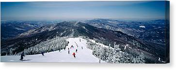 Aerial View Of A Group Of People Skiing Canvas Print by Panoramic Images